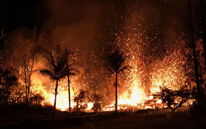 A volcanic fissure with lava fountains as high as about 70m in Leilani Estates, Hawaii.