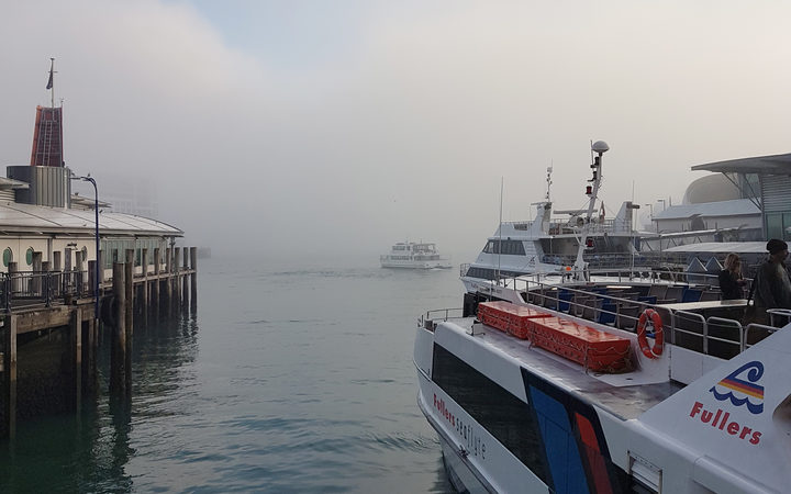Fog in the harbour as seen from the Downtown Ferry Terminal.