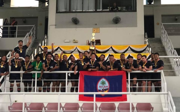 Guam lift the Asia Rugby Championship Division III East trophy.