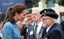 The Duchess of Cambridge greets war veterans in Blenheim.