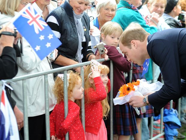 The Duke of Cambridge receives a gift from a young fan.