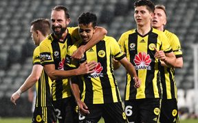 Wellington Phoenix Sarpreet Singh celebrates a goal with teammates during a match against Melbourne City FC.