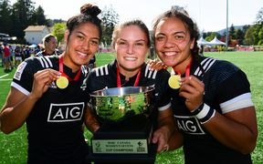 Black Ferns Sevens players Tenika Willison, Michaela Blyde and Stacey Waaka show off their spoils after victory in Canada.