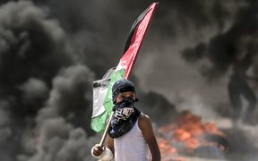 A Palestinian during clashes with Israeli security forces near the border between the Gaza Strip and Israel east of Gaza City.