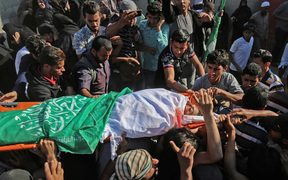 Friends and relatives of Palestinian Mahmoud Abu Taima, who was killed during a protest.