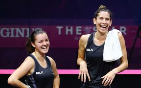 Joelle King and Amanda Landers-Murphy of New Zealand celebrate after winning Commonwealth Games gold.