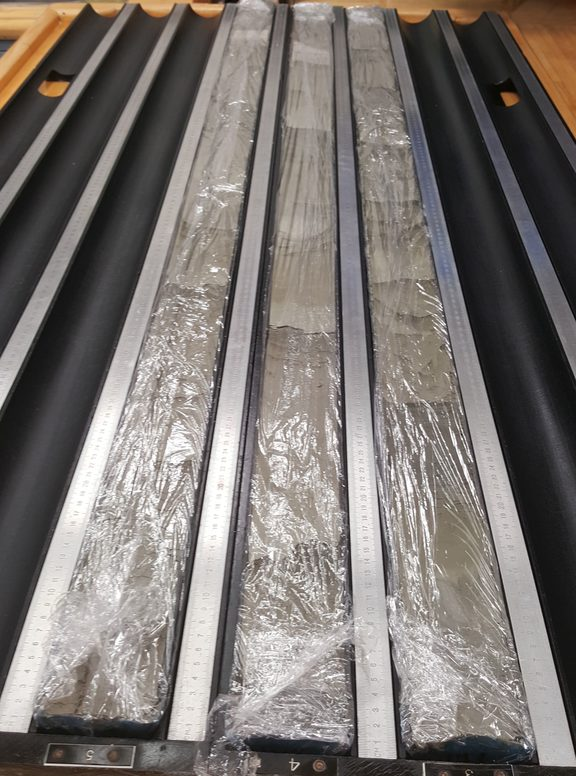 Sediment cores taken from New Zealand's largest earthquake fault. The cores are made up from layers of sand, silt and volcanic ash. The plastic wrap keeps the cores moist.