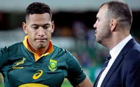Wallaby Israel Folau (left) and coach Michael Cheika.