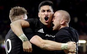 New Zealand's Rieko Ioane celebrates scoring a try with Beauden Barrett and TJ Perenara.