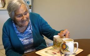 Betty Suttron in her Petone retirement unit with her prized royal mugs.