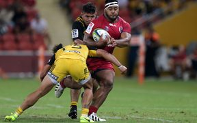 Taniela Tupou on the charge against the Hurricanes.