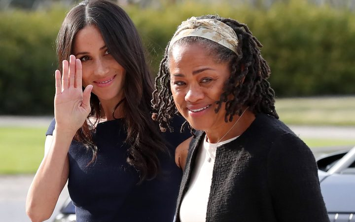 Meghan Markle (L) arrives with her mother Doria Ragland at Cliveden House hotel in the village of Taplow near Windsor on the eve of her wedding to Britain's Prince Harry.