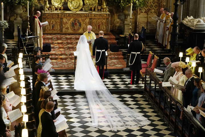 Britain's Prince Harry, Duke of Sussex (R) and US actress Meghan Markle (L) stand at the altar together before Archbishop of Canterbury Justin Welby (C) in St George's Chapel, Windsor Castle, in Windsor, on May 19, 2018 during their wedding ceremony. / AFP PHOTO / POOL / Owen Humphreys