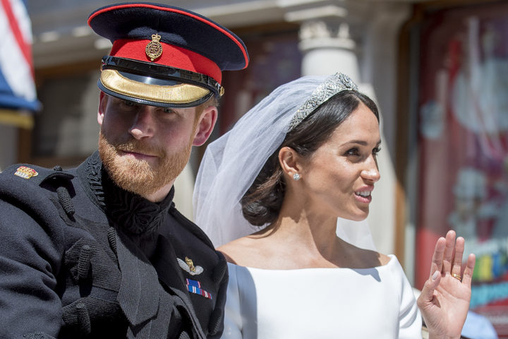 Prince Harry, Duke of Sussex and Meghan Markle, Duchess of Sussex in the Ascot Landau carriage during the procession on The Long Walk after getting married St George's Chapel, Windsor Castle.