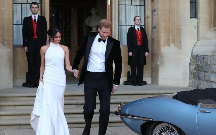 Britain's Prince Harry Duke of Sussex  and Meghan Markle Duchess of Sussex  leave Windsor Castle