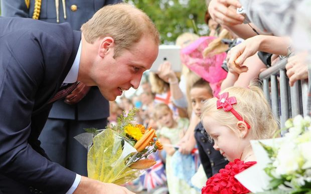 The Duke of Cambridge greets a young fan.