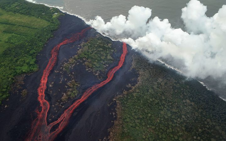 Steam plumes rise as lava enters the Pacific Ocean after flowing to the water from a Kilauea volcano fissure on Hawaii's Big Island