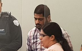 Avneesh Sehgal at his sentencing in the Auckland High Court, with a translator for the court.
