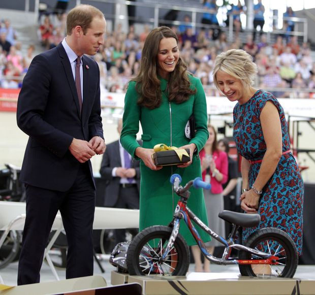 Prince William and Catherine are gifted a bike for baby George, with Olympic gold medallist Sarah Ulmer looking on.