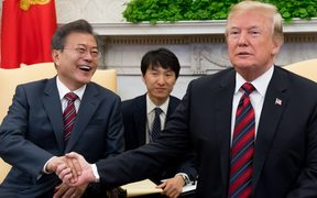 US President Donald Trump and South Korean President Moon Jae-in shake hands during a meeting in the Oval Office of the White House.