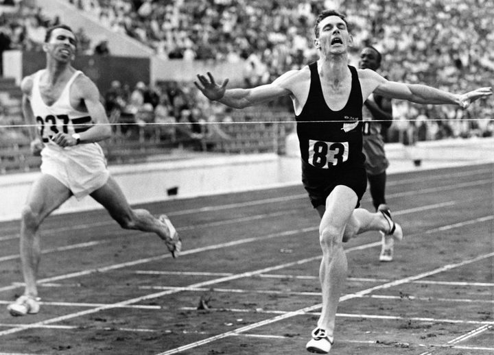 Peter Snell sprints to win the 800m final in front of Roger Moens from Belgium (L), on September 02, 1960, during the Olympic Games in Rome.