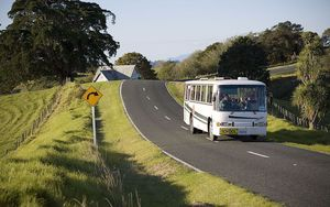 A rural school bus on a country road at Mahurangi West, North Auckland.