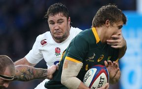 Englishman Brad Barritt tackles South Africa's Pat Lambie