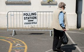 A voter arrives at a polling station in Dublin.