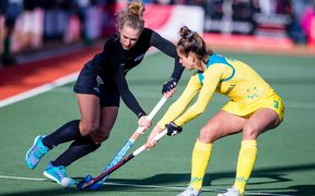 New Zealand's Frances Davies battles for possession with Brooke Peris of Australia during the Tri-Series final in Cromwell.