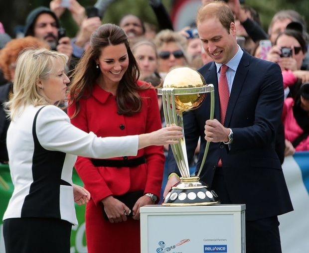 The royal couple inspect the 2015 Cricket World Cup trophy.