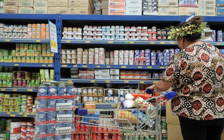 A woman buying groceries in the Cook islands.