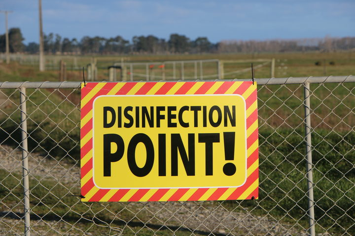 A disinfection point sign on a farm under restricted movement notice due to Mycoplasma Bovis.