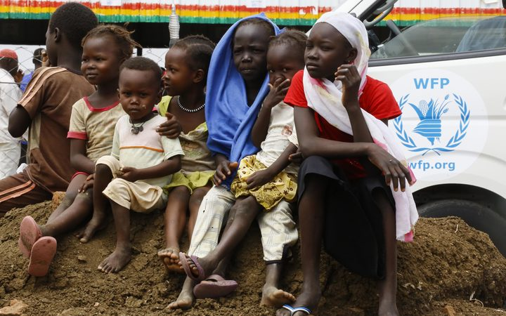 Displaced children sit at a camp near Kadugli, the capital of Sudan's South Kordofan state