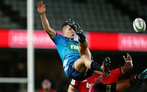 Matt Duffie of the Blues clashes in the air with Manasa Mataele of the Crusaders.