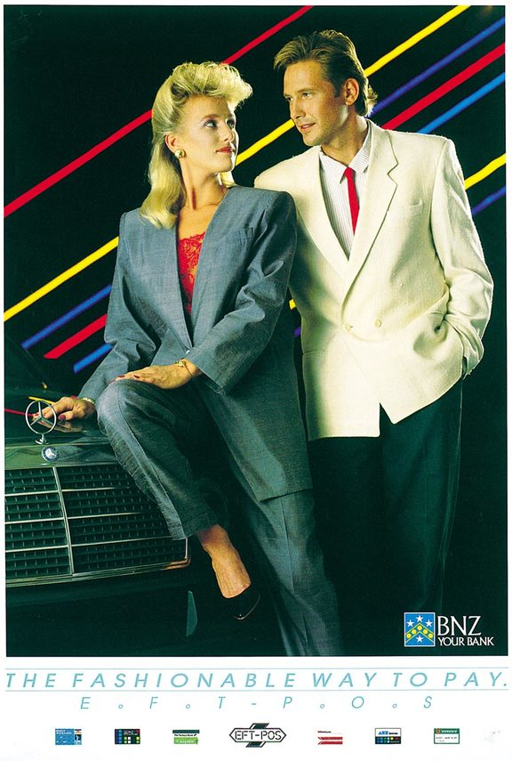 "An image of a poster advertising EFTPOS. Two sharply dressed people lean against the bonnet of an expensive car. The caption reads ""the fashionable way to pay."""