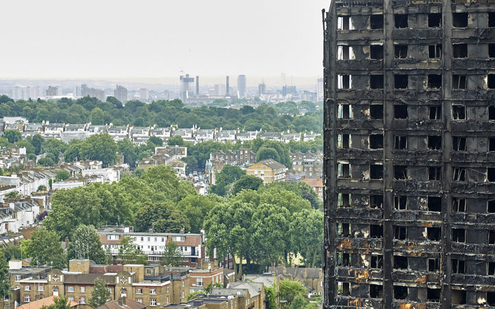 The charred remains of clading are pictured on the outer walls of the burnt out shell of the Grenfell Tower block