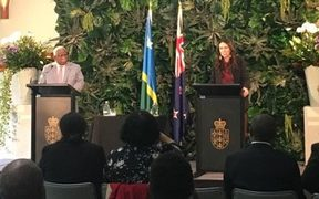 Solomon Islands PM Rick Hou, (left) and NZ PM Jacinda Ardern
