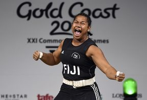 Eileen Cikamatana celebrates on her way to winning gold in the women's 90kg weightlifting final at the 2018 Gold Coast Commonwealth Games.