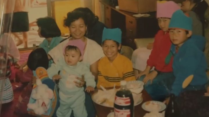 Lucy Zee (in the pink hat) with her family