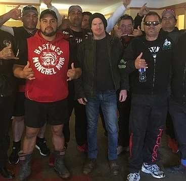Gang expert and academic, Jarrod Gilbert. (centre) standing with group of men