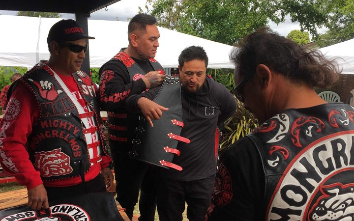 Mongrel mob member puts on patch for the first time.