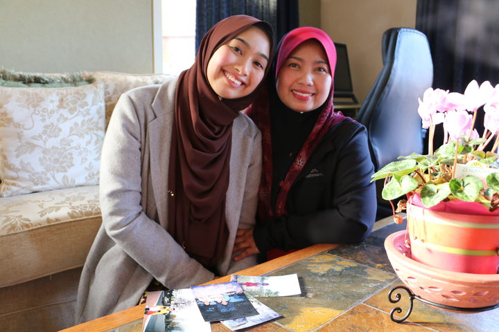 Surprised by Nurul's decision to enter the pageant, mum Anie at home with Nurul (right).