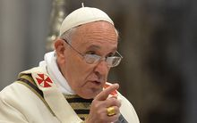 Pope Francis speaks during Mass on Holy Thursday at St Peter's Basilica.