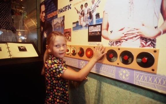 The 'Sounds Pacific' Interactive display, which featured the Isa Lei song, with Te Papa visitor Isabella Smith-Tinirau.