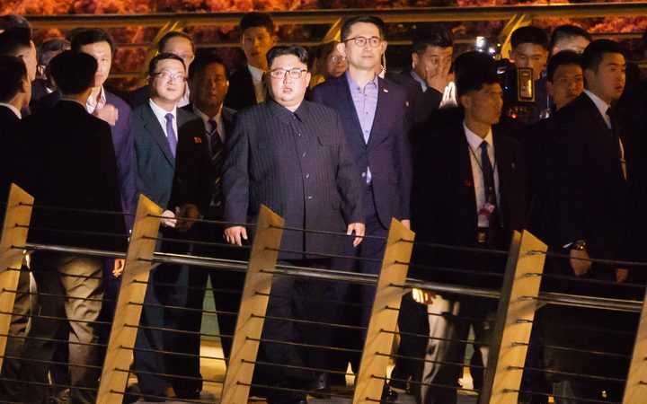 North Korean leader Kim Jong-un (centre) touring Singapore's Marina Bay Area, on a night-time stroll around some of Singapore's sights.