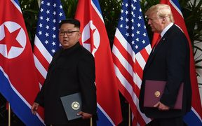 North Korea's leader Kim Jong Un and US President Donald Trump after taking part in a signing ceremony at the end of their historic US-North Korea summit, at the Capella Hotel on Sentosa island in Singapore.
