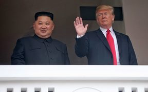 North Korea's leader Kim Jong Un (L) and US President Donald Trump (R) together during a break in their talks at the historic US-North Korea summit, at the Capella Hotel on Sentosa island in Singapore.