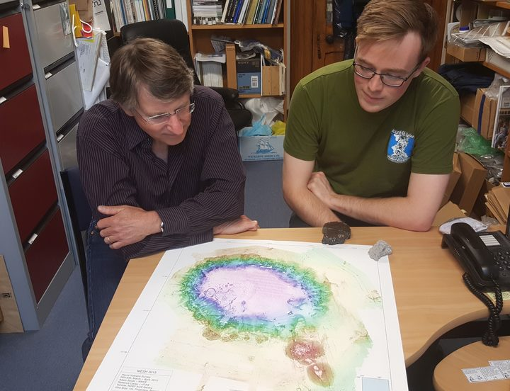 James White and Arran Murch with a detailed map of Havre volcano showing how it looks after a big eruption in 2012.