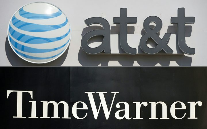 An AT&T cellphone store (TOP) in Springfield, Virginia, on October 23, 2014, and the Time Warner company logo on the front of the headquarters building, 24 November, 2003 in New York. 