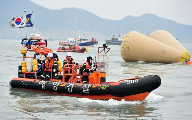 South Korean rescue members search for missing passengers on the capsized ferry.